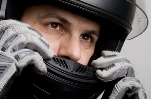 Man-with-Motorcycle-Helmet-300x197